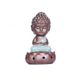 Baby buddha ceramic incense burner seating on lotus for incense coils