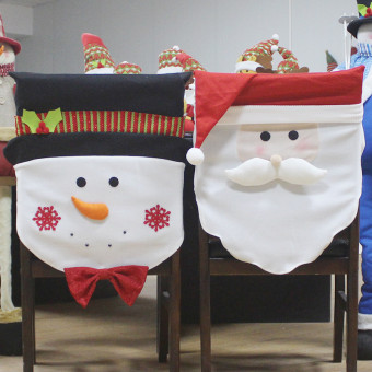 Christmas kitchen chair slip covers featuring Santa Claus and Snowman